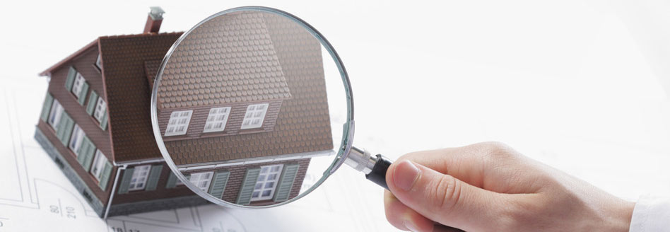 magnifying-glass-and-house